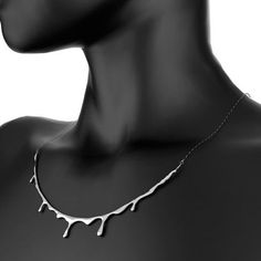 This skinny drop shape necklace projects a dark meaning in a beautiful way. As the silver blood drips, they are frozen in time and lie softly around your neck. Made from polished sterling silver, Bloody Necklace is surely a jaw dropper.TouchOfModern