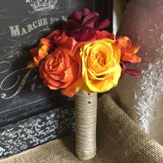 This Listing includes 1 Silk Burnt Orange Roses, Yellow roses, Burgundy Roses, Real Touch Orange calla lilies, Orange Alstromeria Wedding Bouquet wrapped in Natural Burlap. ** The Bouquet is Made to O