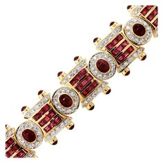 18K Yellow Gold Ruby and Diamond Bracelet with Oval and Princess Cut Rubies. Approximately 2.50ctw of Diamonds, H/I in Color and SI in Clarity.