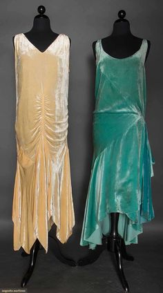 TWO SILK VELVET EVENING GOWNS, 1928-1932. Both sleeveless, low necklines: 1 aqua, bias cut skirt w/ uneven hem lengths, left hip sash, attached silk charmeuse slip. 1 cream, below hip bias cut skirt w/ handkerchief hem skirt. Front