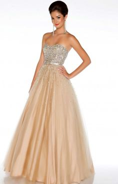 Mac Duggal 61184H is a dress that is made for a queen! It doesn't get much better than this when it comes to ballgowns, and we all know it! This strapless dress has a sweetheart neckline and a bodice that is showered in stunning sequins and beading! The empire waistline is defined by a small glitzy sash that makes way for the super lovely full skirt!