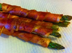 Bacon Wrapped Asparagus ~ Ingredients: 12 pieces of bacon, 12 asparagus spears. Directions: Preheat oven to 400 degrees. After washing & trimming the asparagus spears, simply wrap a piece of bacon on each using a toothpick to secure if necessary. Leave the tips exposed so that you will see the asparagus. Lay the asparagus on a cookie sheet and bake for 20 minutes or until the bacon is cooked. Drain bacon rolls on a plate covered with paper towesl. Serve and enjoy.