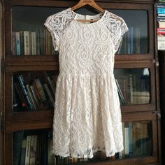 White Lace Dress Above the knee very cute white floral dress. Worn only once! Divided Dresses