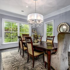 Designer details are throughout this high end dining room. Features include decorative moulding, dark hardwood flooring, luxurious chandelier and modern rugs. Open concept and perfect for gathering of any size! Listed in Vienna, Virginia for $1.6M by The Casey Samson Team is a Wall Street Journal Top Team in Northern Virginia