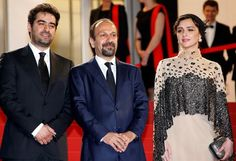 Cannes (France), 21/05/2016.- (L-R) Iranian actor Shahab Hosseini, Iranian actress Taraneh Alidoosti and Iranian director Ashgar Farhadi arrive for the screening of 'Forushande' (The Salesman) during the 69th annual Cannes Film Festival, in Cannes, France, 21 May 2016.
