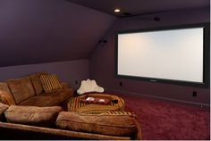 In our house plan....we have the Attic above the garage.....and i found this movie room...exactly what Phil was trying to picture for his CAVE man!!! perfect!!! Except with windows on the side!!!