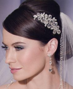 This clear crystal comb won't overpower your gown- it adds classic flair to your look.