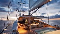 S/Y Vertigo: 220 ft megayacht by Alloy Yachts - dining area & hot tub. You can charter this to Antartica in 2016 for a mere $312K/week :-