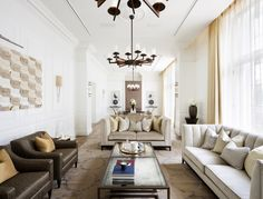 This spacious living room includes bespoke lighting from Dernier & Hamlyn. Designed by 1508 London.