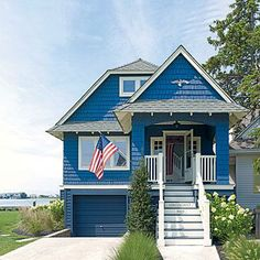 This bright blue beach house has classic nautical style. Coastalliving.com