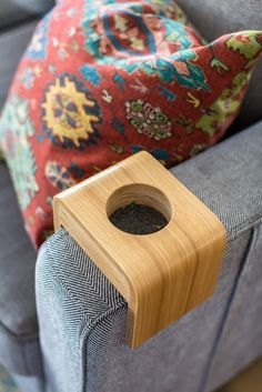 The Cool California Home of the Founders of Health-Ade Kombucha | The combination of California boho meets mid-century chic hits all the right notes, while the open and airy aspects of the house play right into the bright nature of its residents. This arm rest cup holder is an example of that midcentury inspiration!