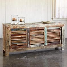 <3 LOVE this piece!  ---Sliding doors made of reclaimed wood, slatted and bearing traces of its colorful past, give this sideboard a unique dimension and superb functionality.
