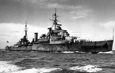 HMNZS Gambia in Hauraki Gulf, 1945.  On 22 September 1943 HMNZS Gambia was commissioned for service with the Royal New Zealand Navy, under Captain N.J.W. William-Powlett DSC, RN. However, the formal transfer did not take place until 8 May 1944, the date that Leander reverted to the Royal Navy.