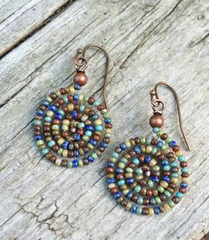 Colorful and light weight beaded spiral earrings made of Czech glass seed beads in turquoise, olive, yellow, blue and red. Approx 1.5 in length.