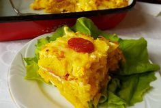 Aperitiv cartofi gratinati cu oua, carnati si cascaval