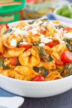 This Spinach and Feta Tortellini is fresh, flavorful, and ready in less than 30 minutes. Cheese tortellini is tossed in a zesty marinara sauce and sprinkled with fresh spinach and crumbled feta cheese. Easy to make and perfect for busy weeknights, this warm and comforting pasta will fill you up and keep you coming back for more! @buitoniusa #Buitoni #CloserToDinner #ad