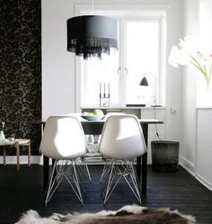 Love the Eames Eiffel base chairs, the wallpaper and the pendant light.  Image from Leva & Bo.