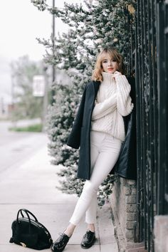 Wearing white after Labor Day is no longer a taboo. Jane picked the perfect winter outfit by combining white on white. She wore a cableknit turtleneck sweater with white skinny, cropped jeans and a pair of black patent leather brogues. She broke up the double white with a navy walking coat and black calf hair bag. This is definitely a look we cannot wait to try.