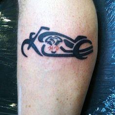 Harley Davidson tattoo on calf