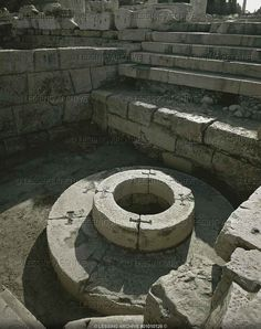 """Sanctuary of Demeter, Eleusis. The sacred well Kalichoron """"of the fair dances"""" around which the women of Eleusis danced in honour of Demeter,"""