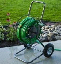 Heavy-Duty Hose Cart rolls easily The two pneumatic tires mounted on sealed ball bearing wheels give you the freedom to easily maneuver up to garden hose anywhere you desire. Includes a leader hose that attaches to the max-flo ou Garden Hose Storage, Garden Hose Holder, Hose Cart, Metal Hose, Hose Reel, Different Vegetables, Water Hose, Garden Furniture, Butler