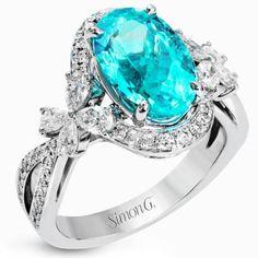 Simon G. 18K White Gold Oval Cut Blue Paraiba Tourmaline & Diamond Ring with a 4.04 Carat Oval Cut Blue Paraiba with 0.97 Carats White Diamonds. Style LP2301-A $55k