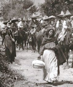 Soldaderas during the Mexican Revolution carrying food next to the Zapatista army, circa 1914