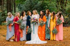 Bright and colorful mismatched bridesmaids' dresses and greenery bouquets at a bohemian wedding in Lakeland, Florida | Jenna Nicole Photography