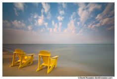 Love the yellow Adirondack chairs looking out over Lake Michigan.