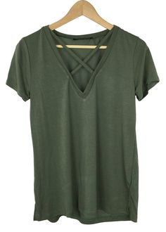 - V-neck front with criss cross detail - olive color - knit fabric with stretch - short sleeves - 30% polyester and 70% modal - made in USA