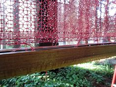 """Nami Yamamoto - Fog Catcher (detail) 2012 Waxed linen, Redwood gutter, metal pole, and hardware each 10'x10'x3"""" When fog goes through a net, condensation happens on the net, and gravity pulls the water drops down to a gutter below the net and collect water."""