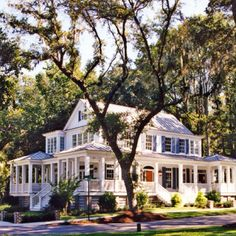 Big white house with lots of windows, trees, and a wrap-around porch. Big white house with lots of windows, trees, and a wrap-around porch. Style At Home, Dream Homes, My Dream Home, Dream Big, Girls Dream, Future House, My House, Ideal House, Awesome House