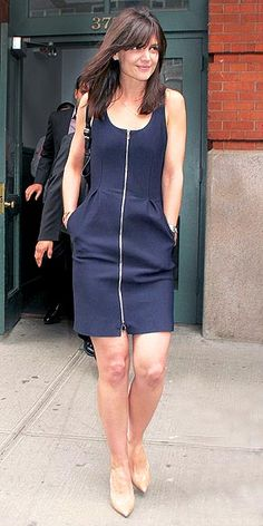 KATIE HOLMES Bangs and a bangin' outfit. Katie shows off her fringe with a perfect blowout and shows off her body with a navy zip-up tank dress at Tribeca Film Festival event in N.Y.C.