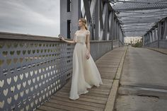 "<span style=""font-weight: 400;"">A romantic 'off the shoulder' beaded lace cropped top with a  full, flowing silk organza skirt</span>"