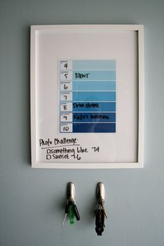 Weekly schedule - dry erase markers on glass photo frame. Love the paint chips!