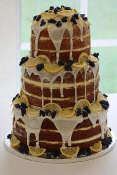 lemon drizzle naked cake decorated with crystallised whole violets and candied lemon