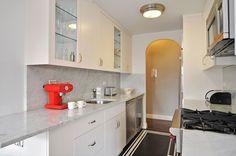 quaker ridge kitchen  carerra marble counter  and back splash  long runner