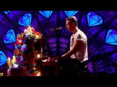 Love this performance and song. The stage set up is amazing and then to see Jonny appear, to rally around Chris in such a heart-wrenching song, is a precious moment. It's a brother moment. I think Chris will always love his wife. I so wish they had never broken up. There's too much pain. Tears.....
