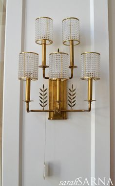 Dining room sconces on wall to kitchen