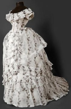 1874 extant gown, off shoulder w/ ruffles, and ruffles on overskirt and around hem