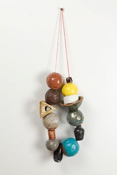 Necklace with oversized, geometric, ceramic art beads