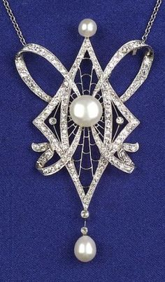Platinum and Diamond Pendant Necklace, c. 1925, bead and bezel-set throughout with single and old European-cut diamonds, approx. total wt. 1.40 cts., with later freshwater pearl accents, suspended from a later 14kt gold trace link chain, lg. 16 3/4 in.