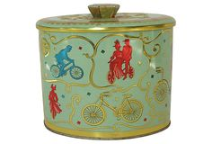 """Vintage tin with an embossed bicycle design. Marked """"Baret Ware Art Grace Made in England"""" on the underside."""