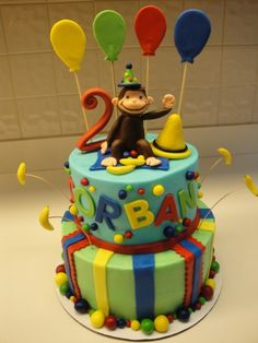 Curious George Cake By smcakes on CakeCentral.com  *use colored chocolate covered cherries, strawberries, etc. on bottom*
