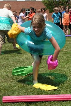 Inner tube, swimmies and swim fins; You would think that Lanigan Elementary School second grader Makayla Kitts would be headed to the beach, but instead she's competing in the Swim Fin Relay Race at the school's annual game day event.