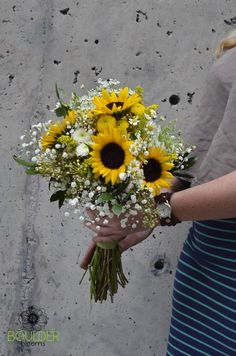 Bridal Bouquet with mini black eyed sunflowers, white pom pom mums, babies breath, queen anne's lace, feverfew, and yellow button pom pom mums. -Boulder Blooms