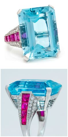 An aquamarine cocktail ring with rubies and diamonds in a platinum setting.