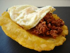 """Tortos de maíz con picadillo y huevo"". Typical asturian cuisine, it's made of maize-flour tortilla, often fried until it puffs up; then added chopped fried ""chorizo"" (cured pork seasoned) ​​and fried egg on top."