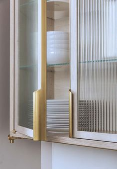 Reeded Glass cabinet with brass hardware Glass Kitchen Cabinets, Glass Cabinet Doors, Kitchen Doors, Glass Shelves, Glass Doors, Farmhouse Cabinets, Handles For Kitchen Cabinets, Metal Cabinets, Yellow Cabinets