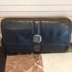 Tory Burch Leather Wallet Trading with Dooney It's used but still in good shape soft black leather front compartment for papers zips around credit cards both sides with money and zip change purse in middle trade 200 Tory Burch Bags Wallets